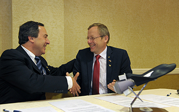 Mark Sirangelo, Corp. VP and Prof. Jan Woerner, DLR sign agreement.