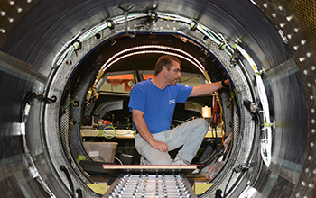 SNC Technician Inspects Interior Cabin of SNC's Dream Chaser ETA