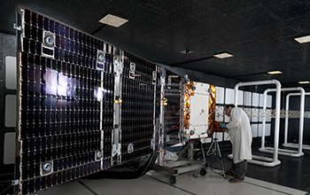 SNC Engineer Checks OG2 Spacecraft Fully Deployed in Radio Frequency Chamber