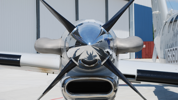 The shiny, metallic propeller of an airplane