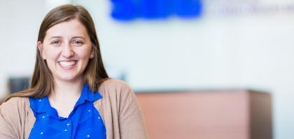 Smiling millennial SNC employee. Learn more about opportunities for students.