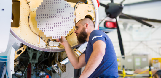 SNC engineer building a piece of airplane technology