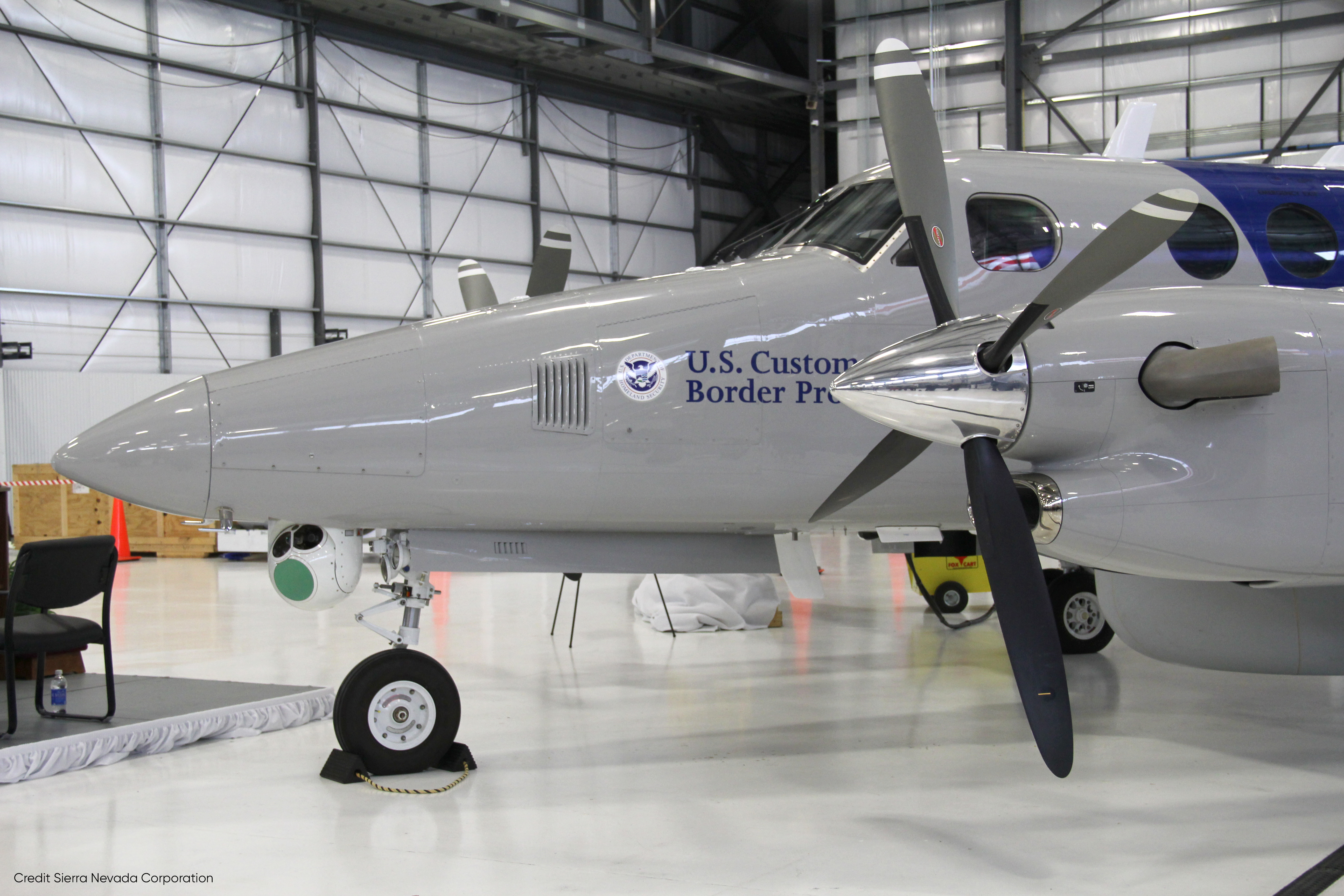 CBP Multi-role Enforcement Aircraft in Hangar - Sierra Nevada Corporation